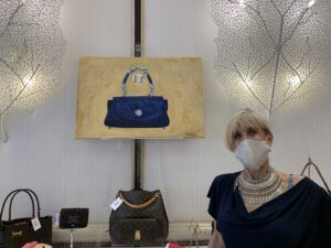 Jill karlin with Painting of The It Bag